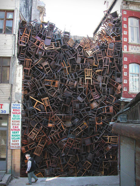Doris Salcedo, 1550 chairs stacked between two city buildings